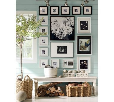 no only is this my second recent feature of decorating with black and white  photos, but also one of a pottery barn gallery arrangement. what can i say?  they ...